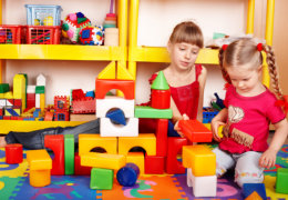 Two girl playing toy block